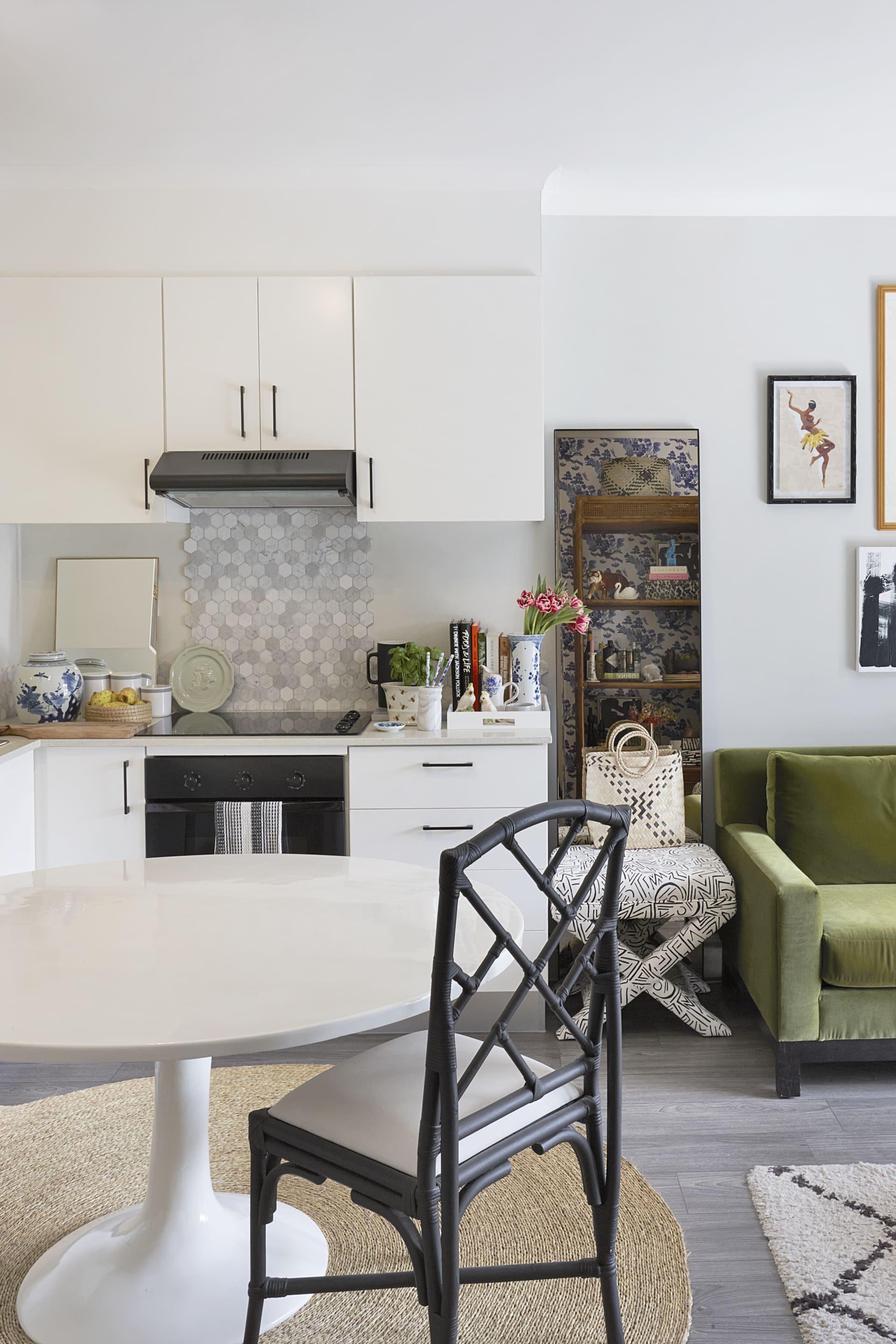 The compact and open kitchen and dining area boast aSaarinen Tulip table by Knoll and other statement finishes and furniture.© Micky Hoyle