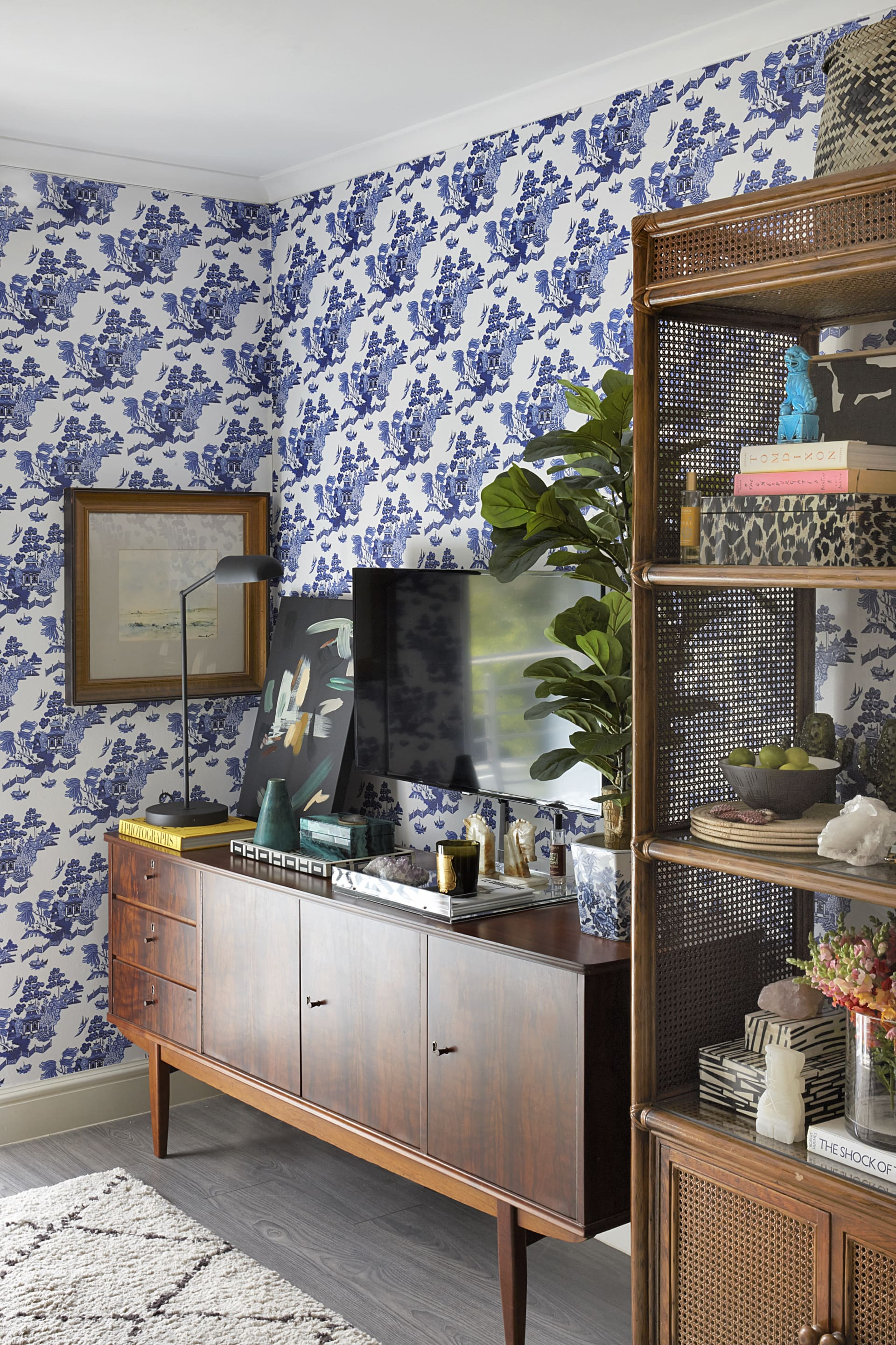 A vintage sideboard and cane bookcase showcase treasured items.© Micky Hoyle