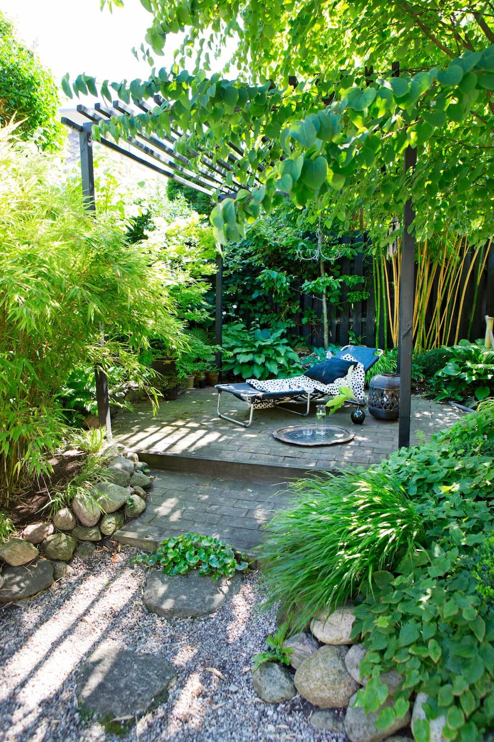 Upstairs is a paved patio surrounded by various kinds of bamboo.