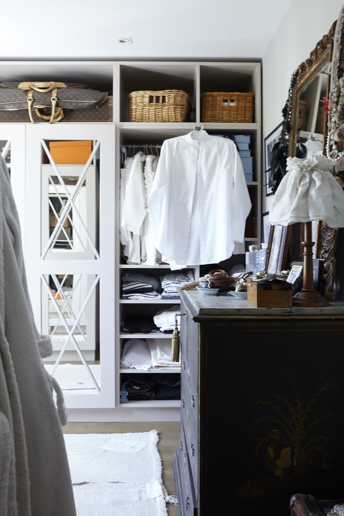 Anna's dressing room has built-in shelves and cabinets that she designed herself. The worn-down Chinese dresser was bought at an auction.
