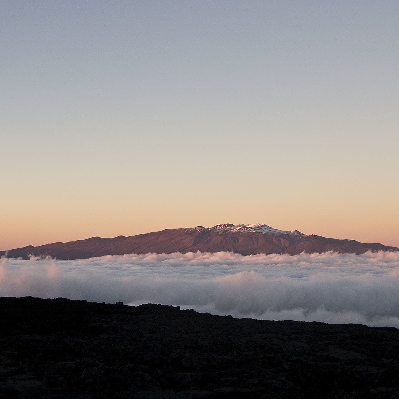 """Mauna Kea, the world's highest mountain measured from the foot of a mountain to its peak.But only"""" 4205 meters above sea level."""