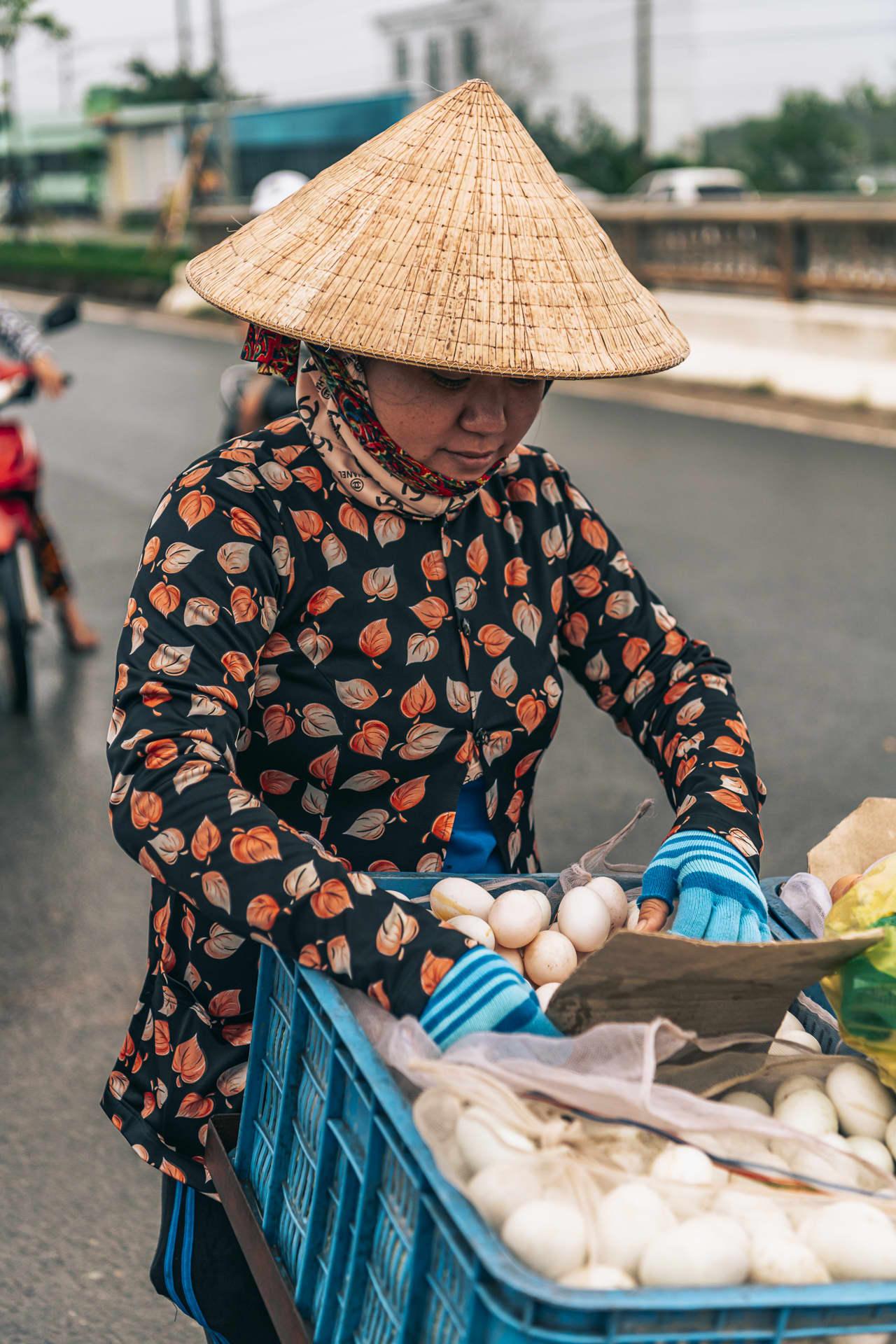 A Vietnamese woman selling fresh eggs at the Cau Sau market.