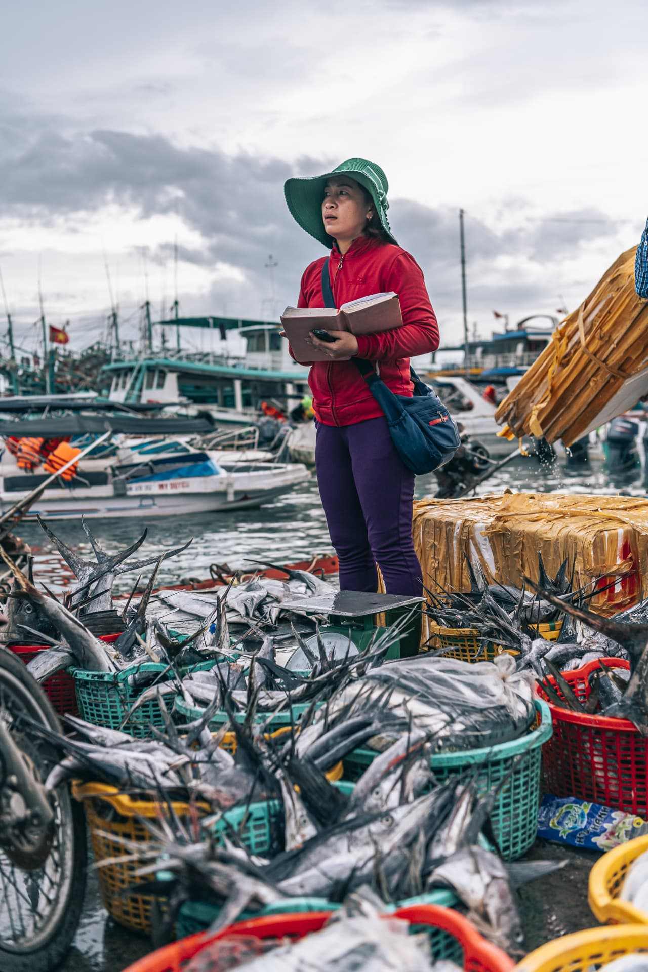 A woman keeping an eye on the day's catch at the Phu Quoc fishing port.
