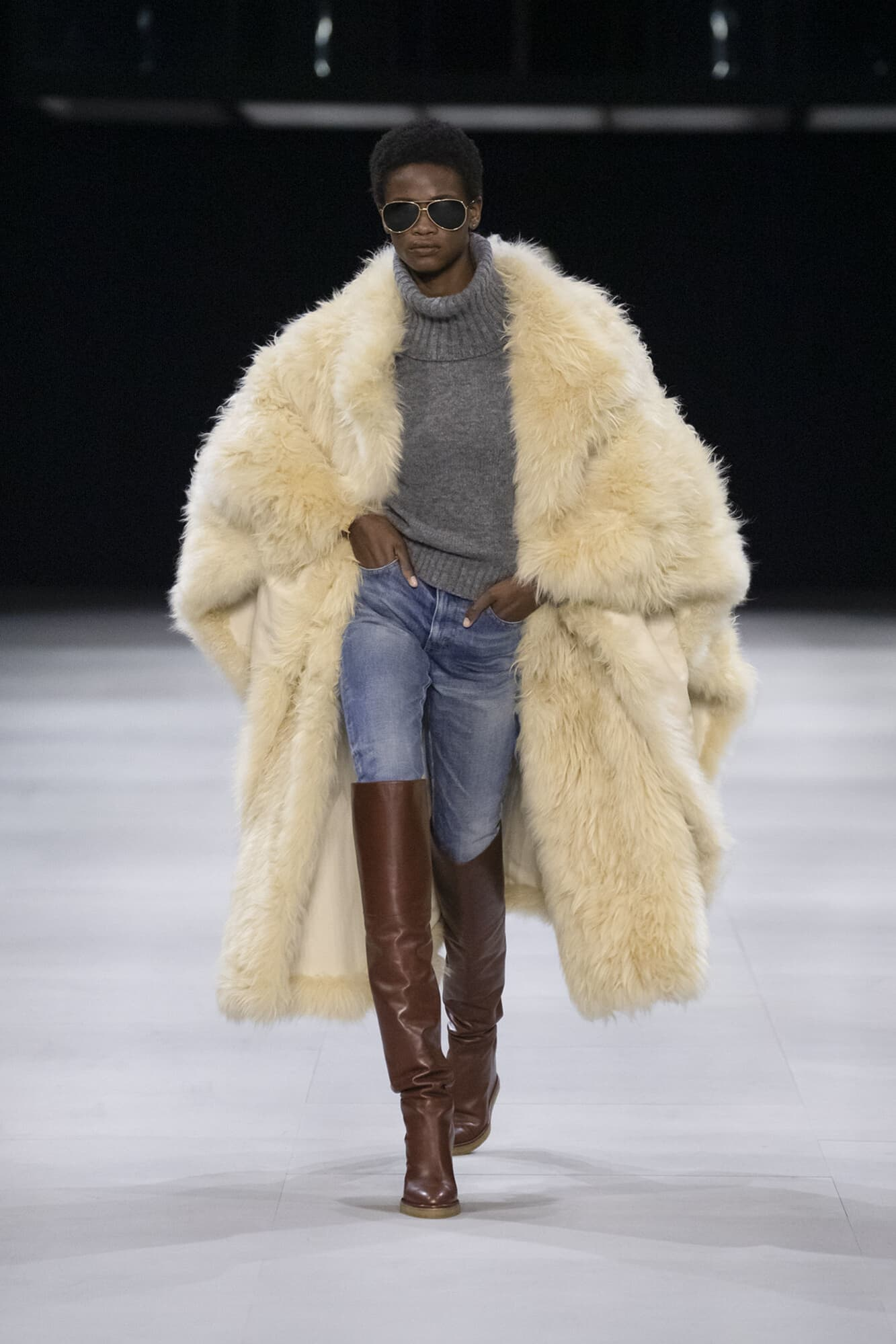 The big fake fur... and the worn jeans.