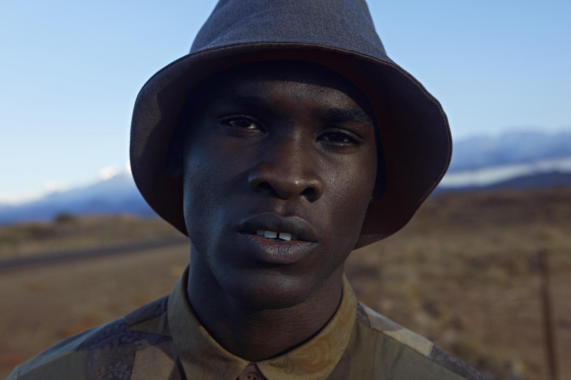 ALC Menswear bucket hat. ALC Menswear camo Shweshwe shirt.