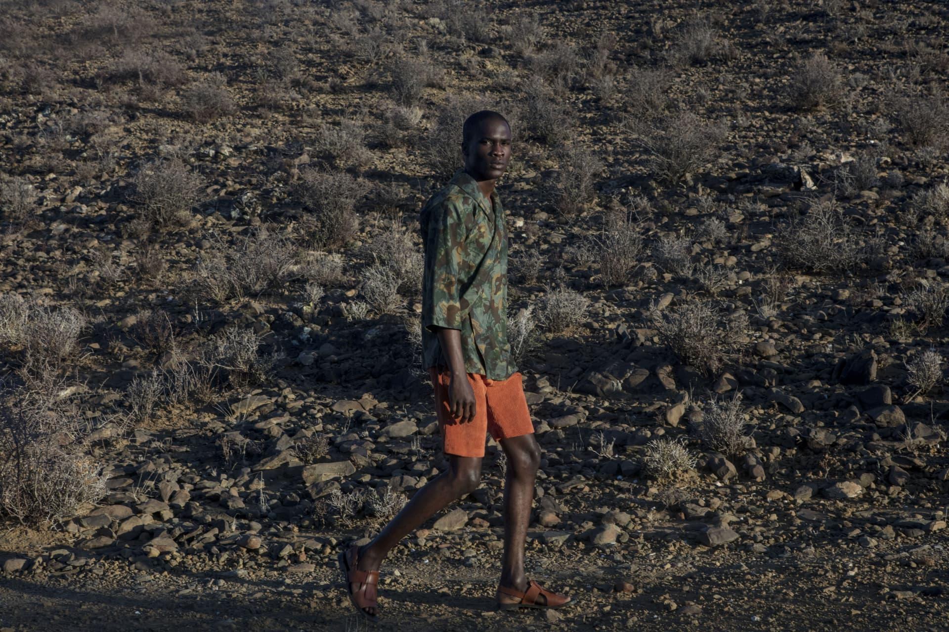 Floyd Avenue camo wrap top. Nicholas Coutts corduroy shorts ALC Menswear sandals.