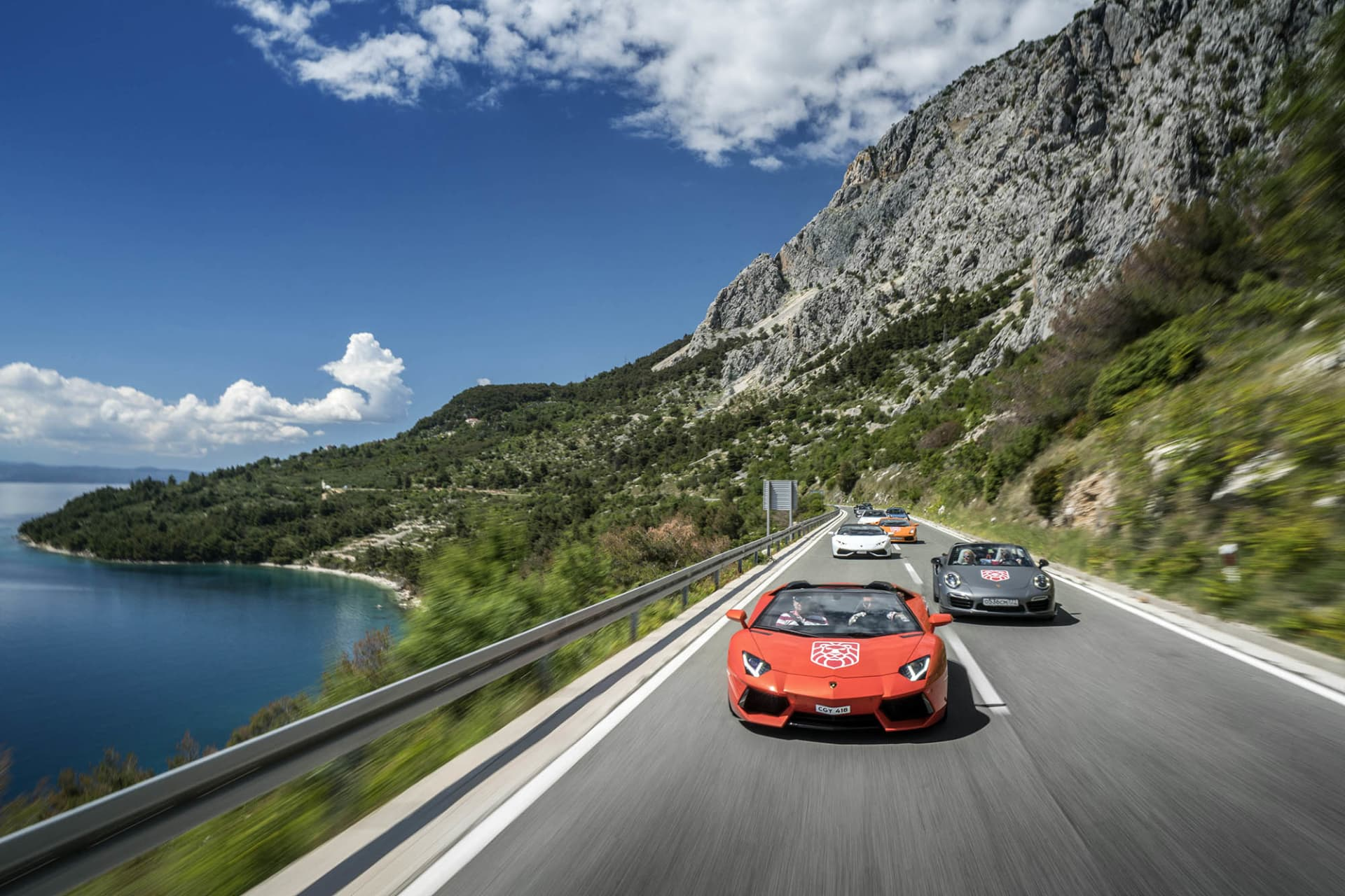 Supercars on the coastal road in Croatia during the annual Gran Turismo Adriatica event.