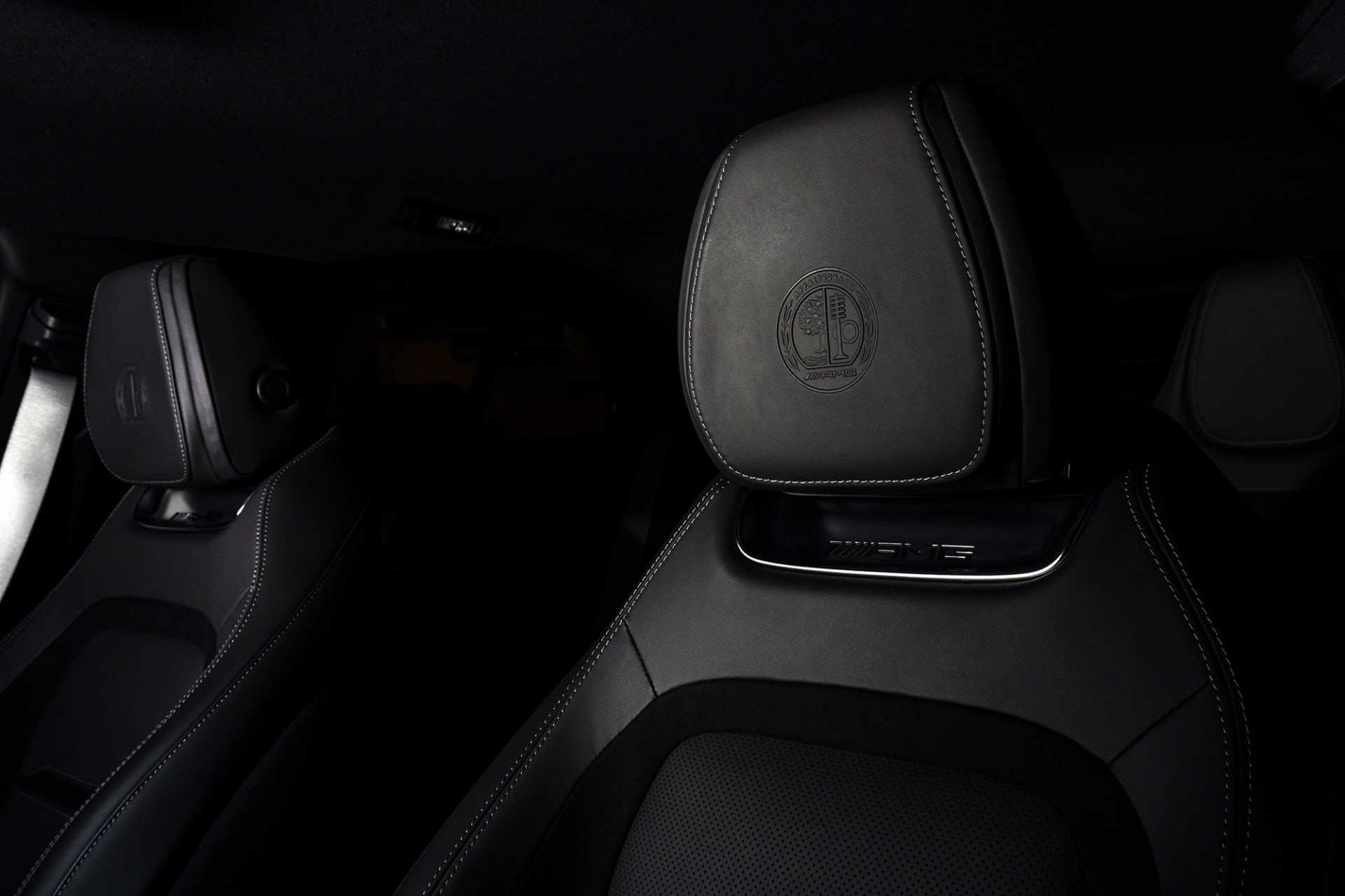 In the headrests, the classic AMG emblem is embossed.