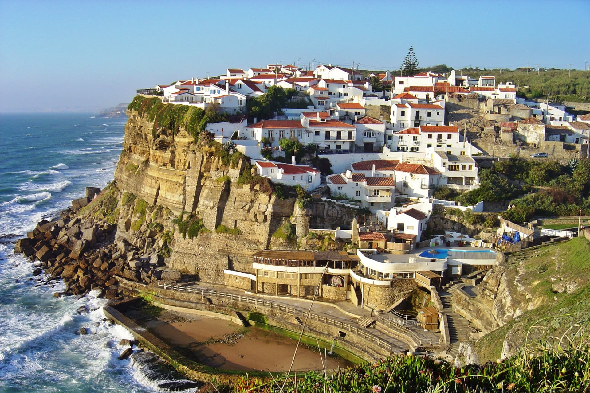 The hilltop village of Azenhas do Mar, along with the coast of Colares. Photo credit: Leoboudv.