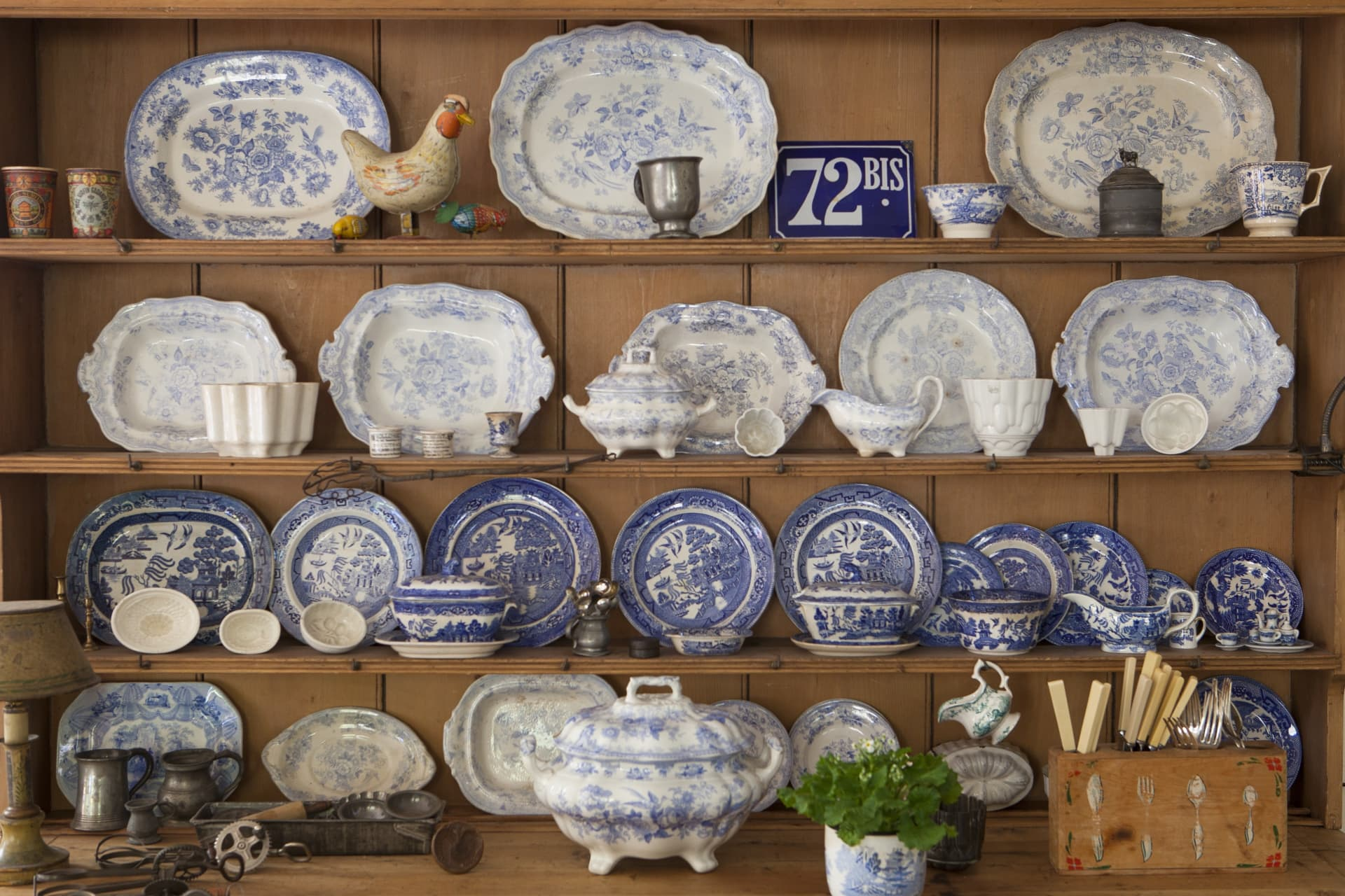 The large antique pine dresser holds a small part of Glenny's large collection of blue and white china.