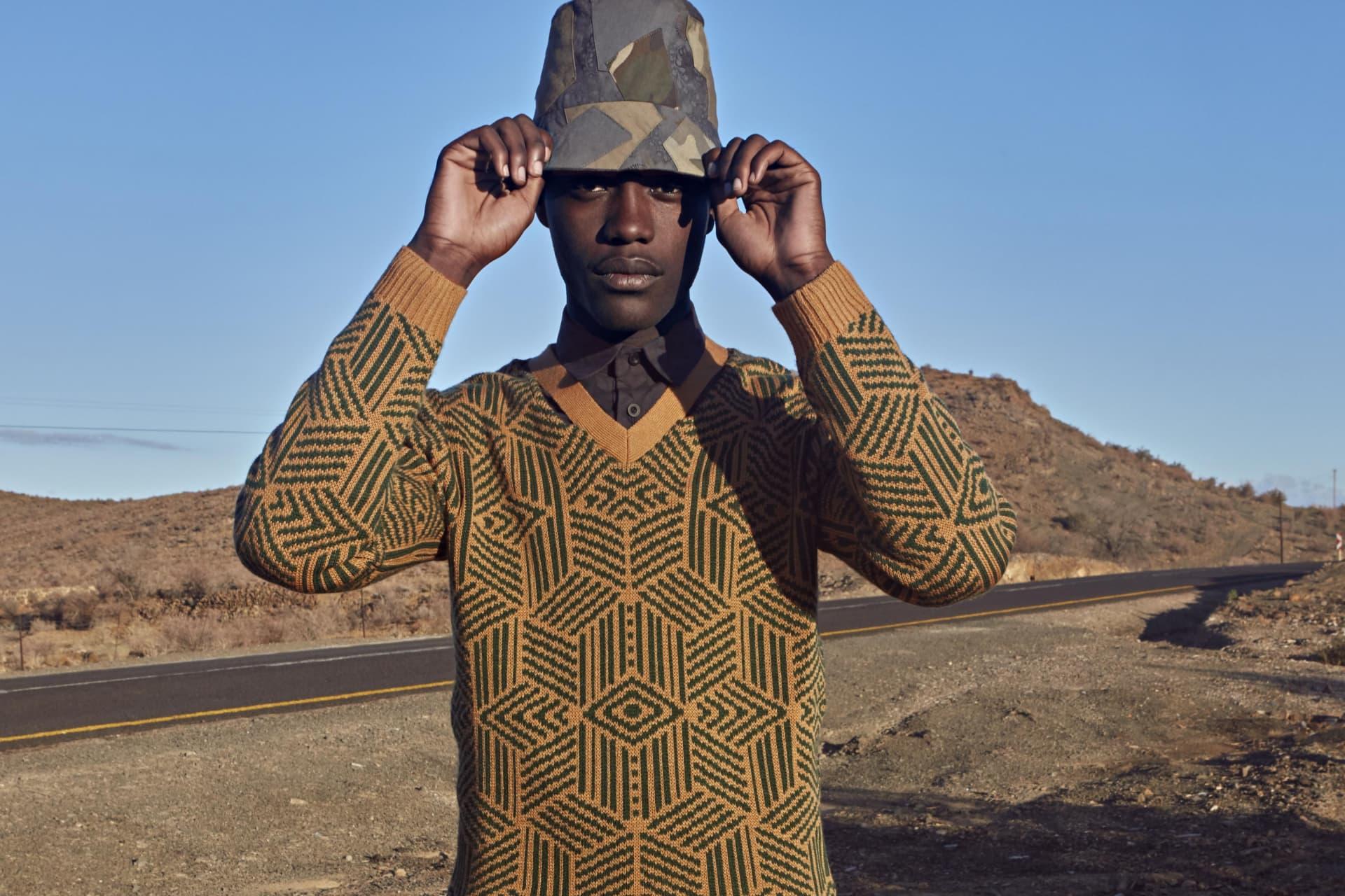 ALC Menswear camo Shweshwe bucket hat. ALC Menswear Shweshwe shirt. Chulaap Shweshwe knit.