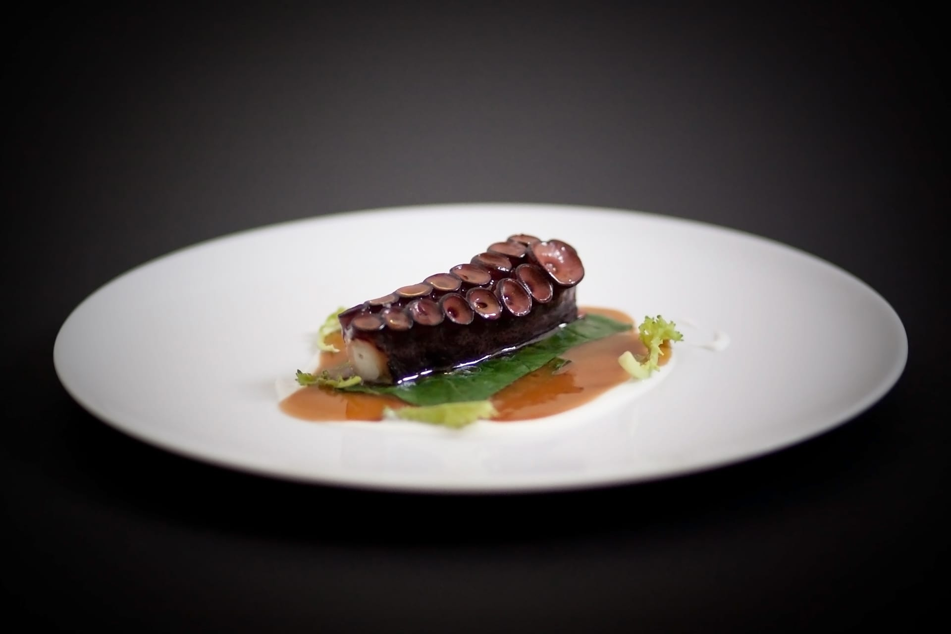 """Caldeirada (octopus stew with among others, citrus). """"I came up with the idea of making a contemporary Galician cuisine in which the traditional dishes of the house kept the protagonism""""."""