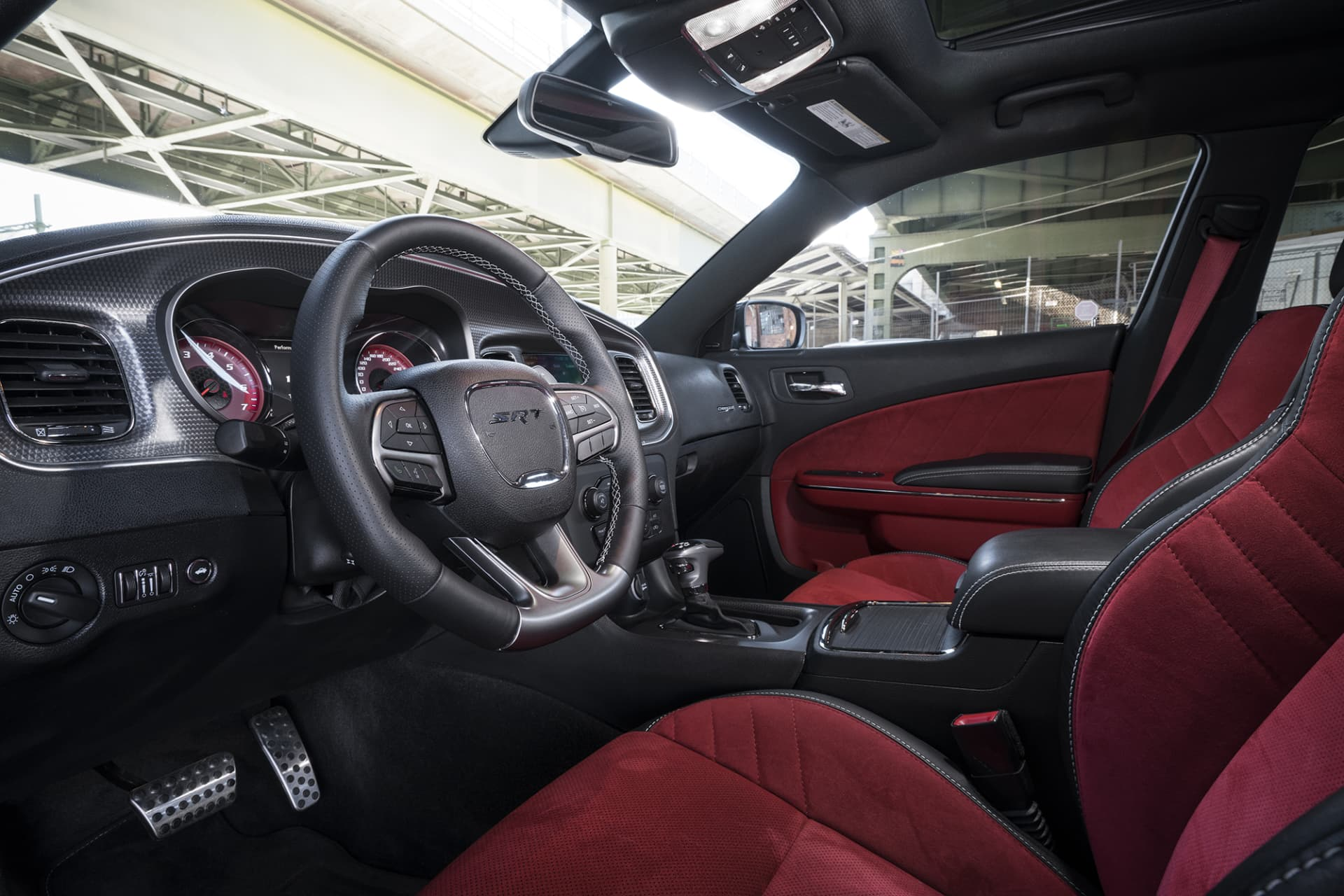 Despite the snazzy Alcantara-interior in red, the quality does not quite match many German competitors. But you're seated very comfortably and when the pedal hits the metal and the power is released, you quickly forget the details of the interior.