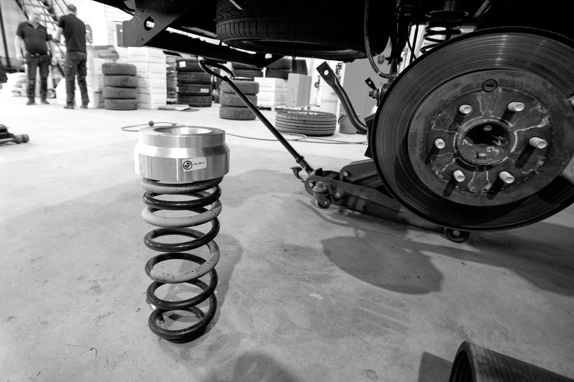 In order to perform the suspension lift, washers are used to extend the springs.