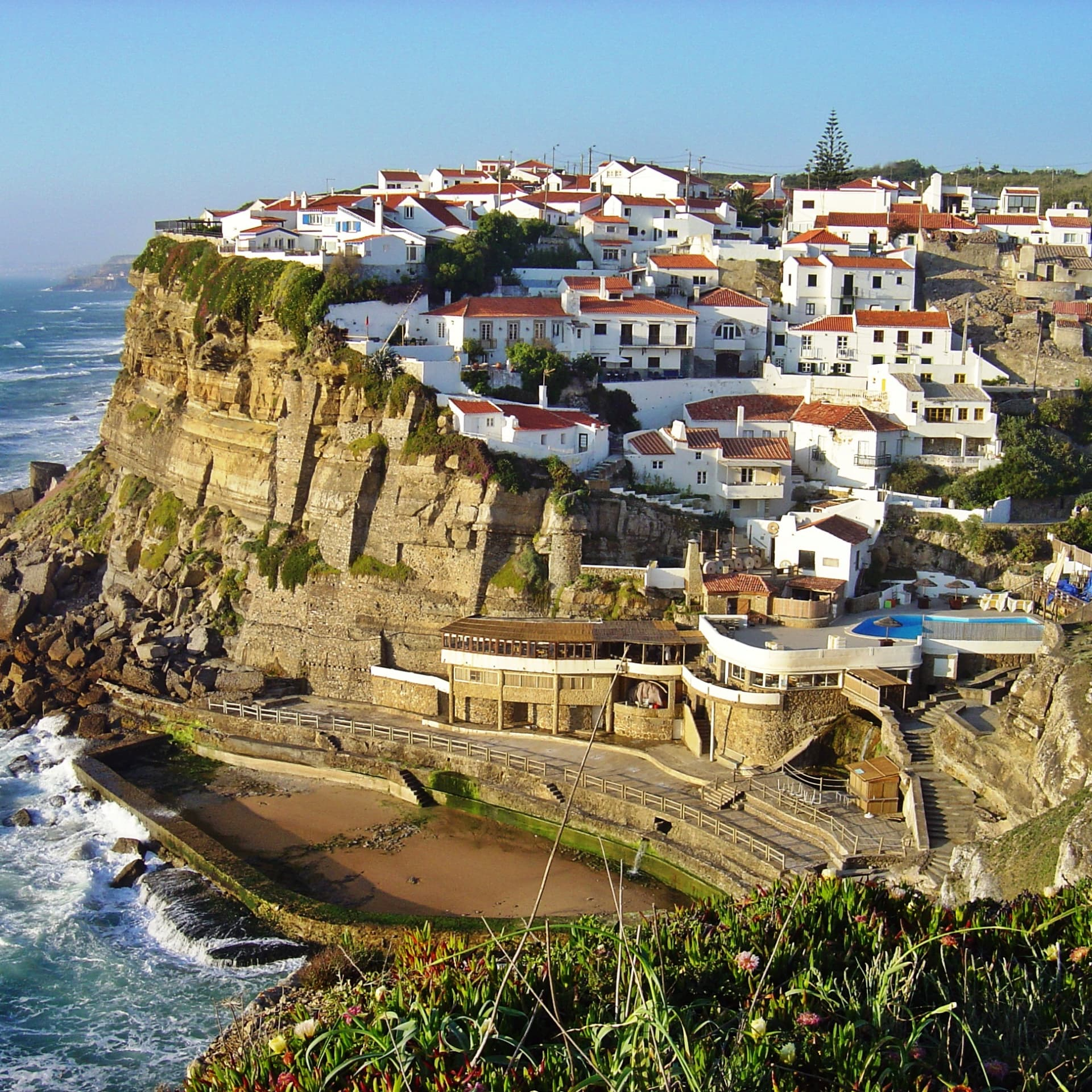 The hilltop village ofAzenhas do Mar, along with the coast of Colares. Photo credit:Leoboudv.