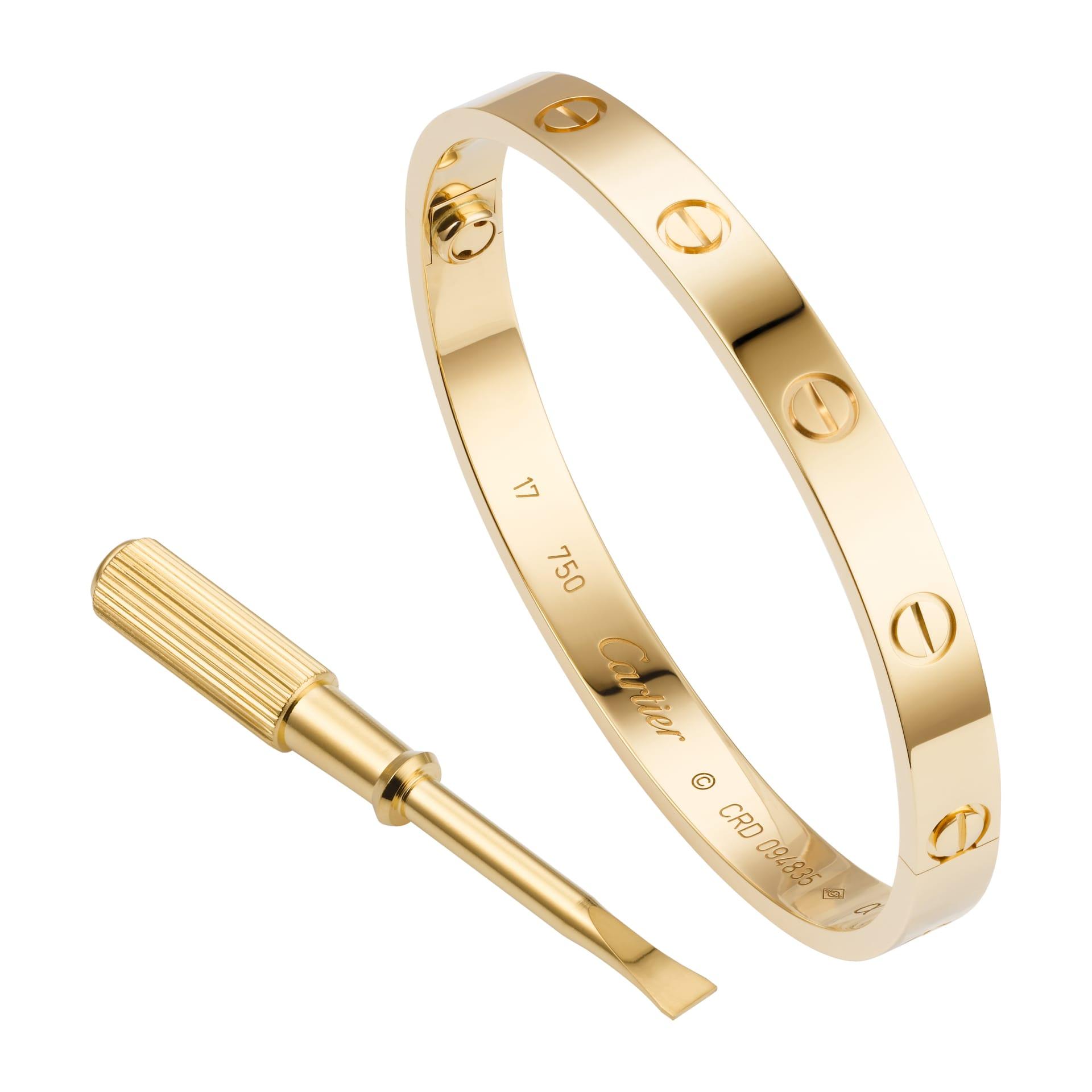 Love Bracelet med den rätta skruvmejseln för att kunna öppna och stänga armbandet. © Cartier