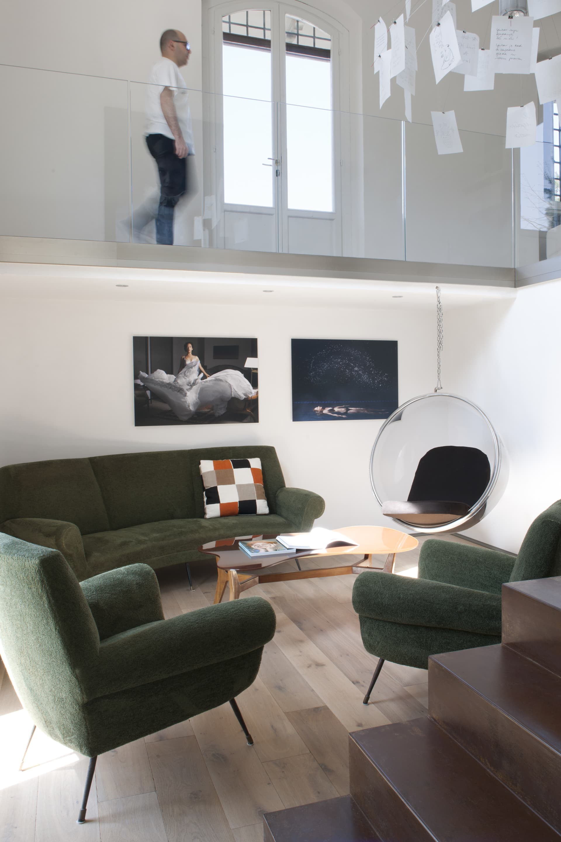 Bubble Chair by Eero Aarnio combined with vintage sofa and armchairs, and photographs on the wall by Margot Quand Knight.