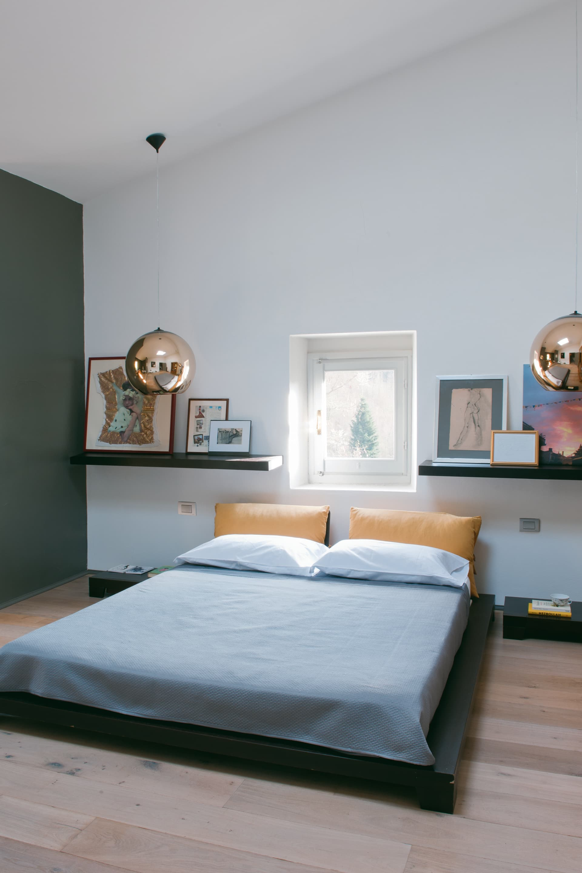 The bedroom with Copper Shade lamps by Tom Dixon.