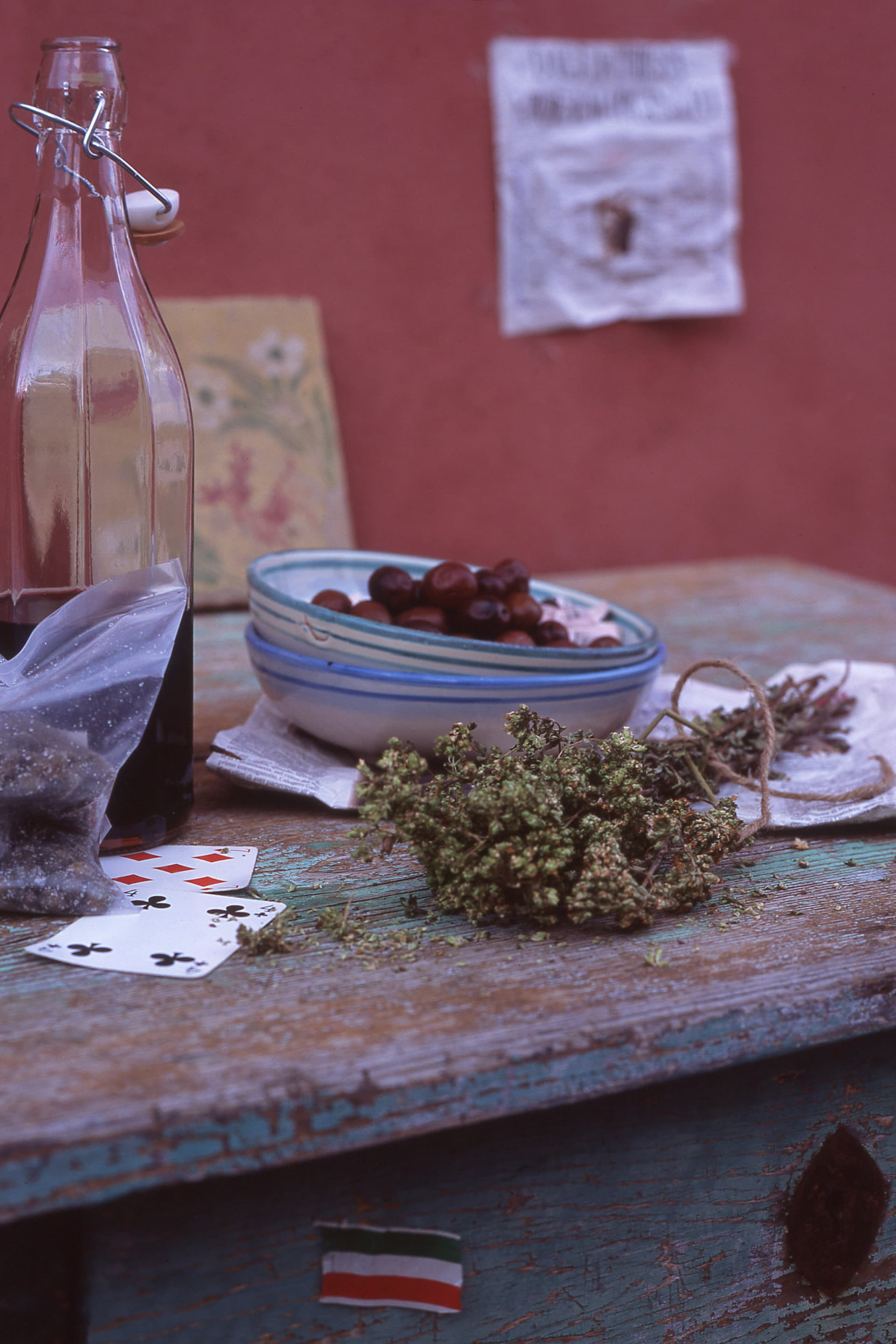 On the table, local specialties such as salted capers, oregano and olives.