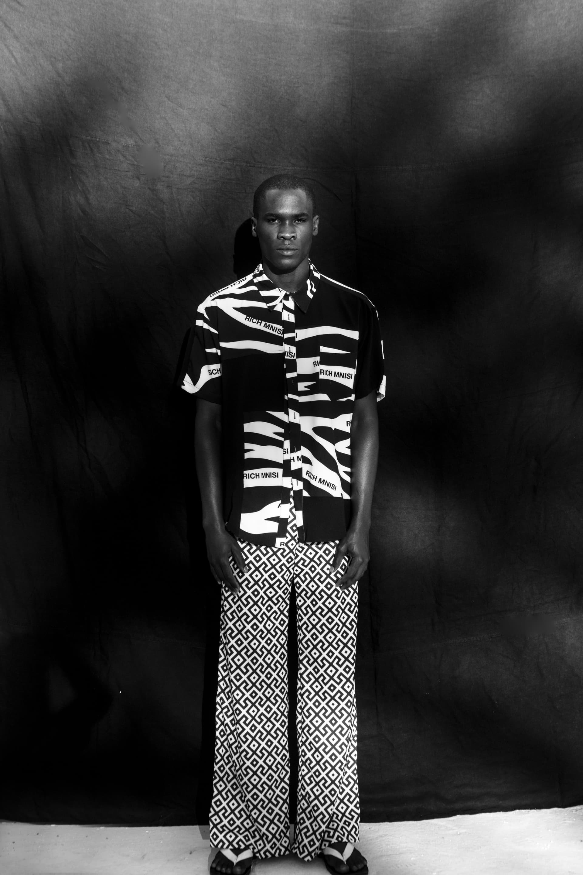 Shirt by Rich Mnisi. Trousers by Leigh Schubert at The Space.