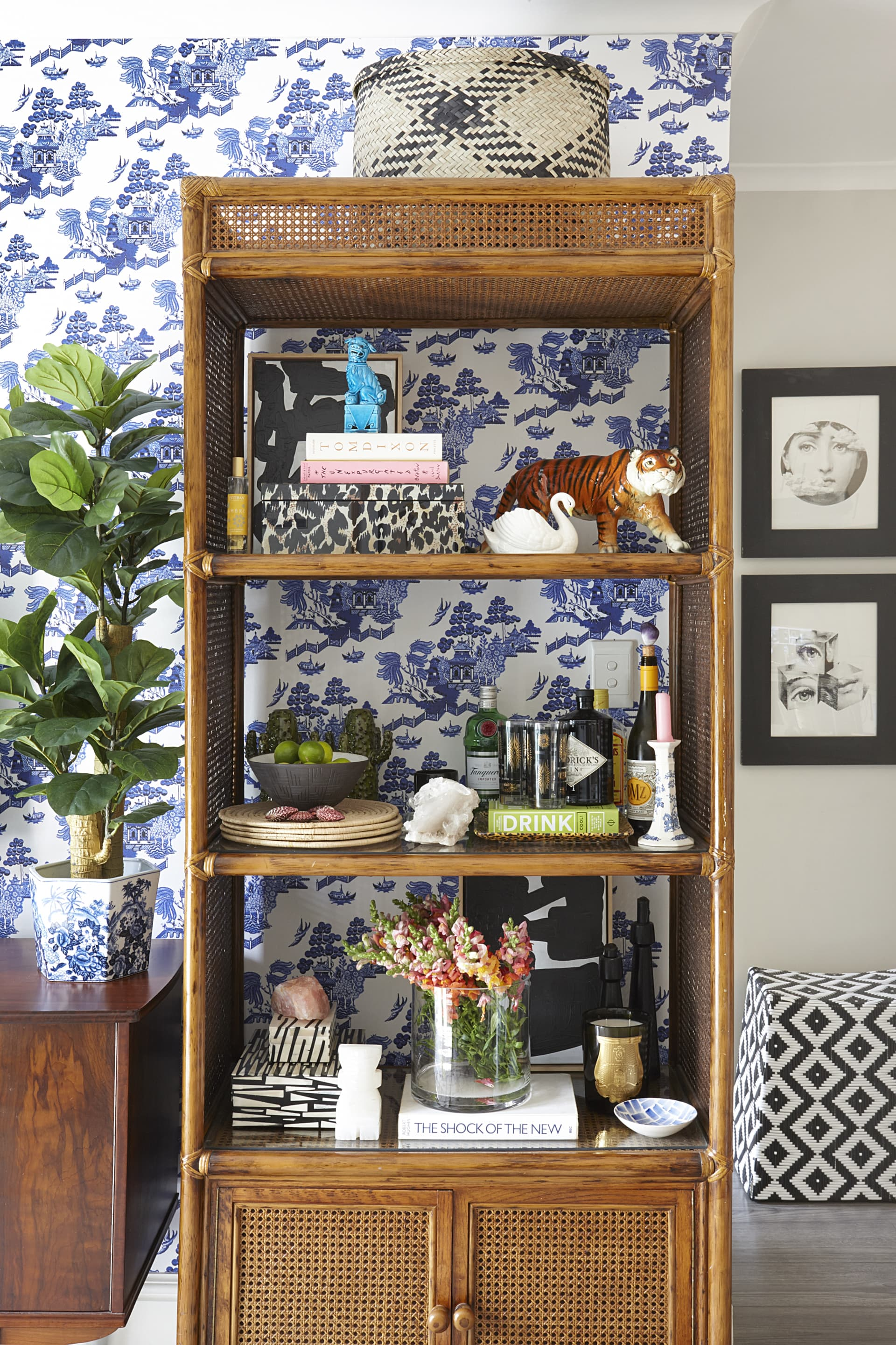 The homeowner's inherited open-shelved cane bookcase serves as both a drinks station and display unit. © Micky Hoyle