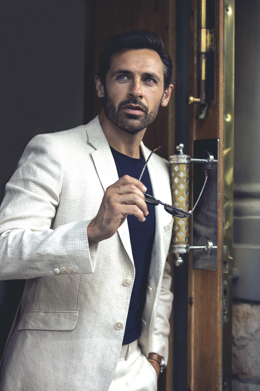 White suit, Pal Zilieri. Blue t-shirt, Lacoste.