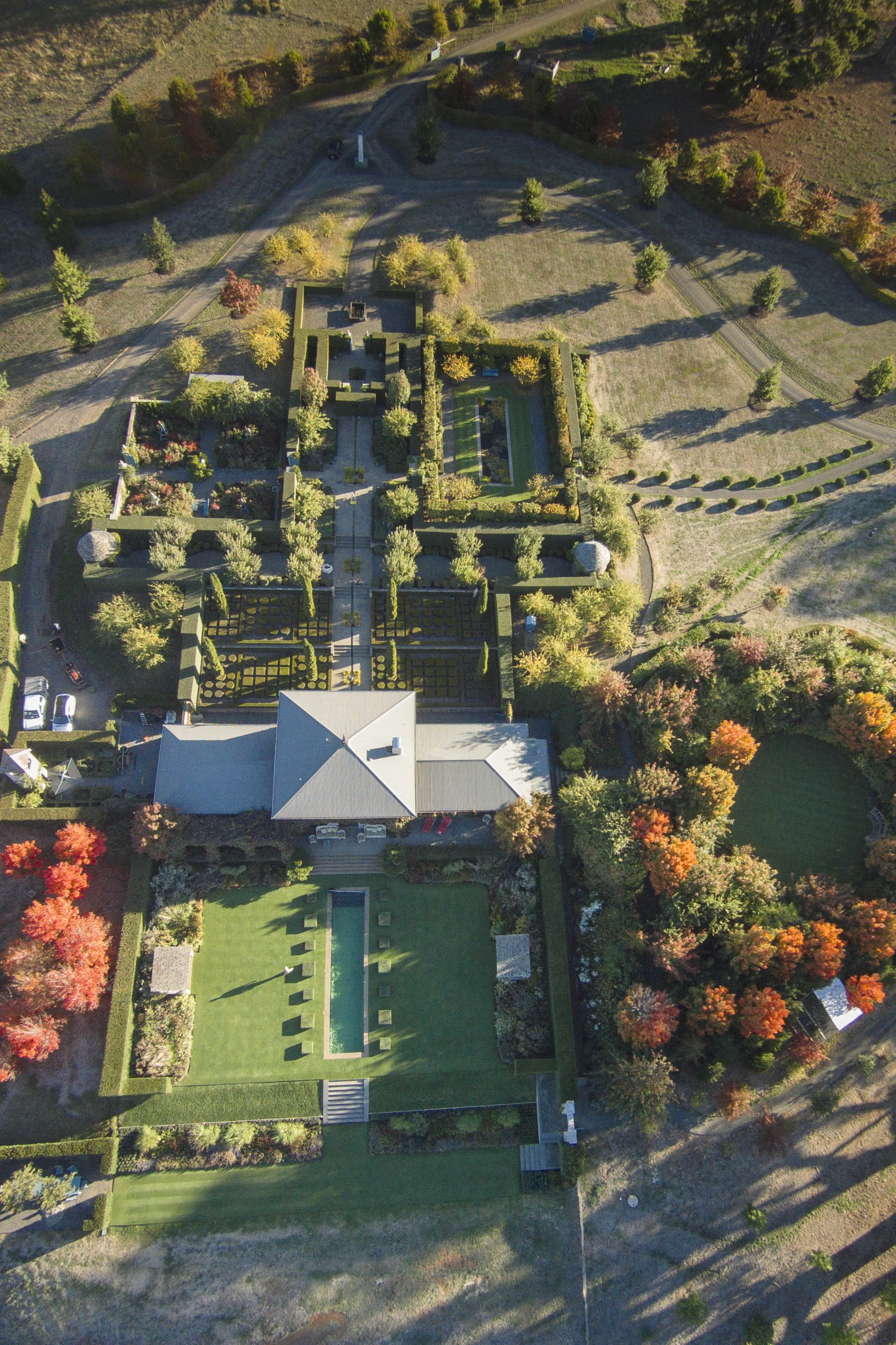 From the air, it's easy to see the way the garden has been divided into rooms and how the circular woodland garden is coloring up in autumn. Each year the garden gets a little bigger, it is a work in progress.