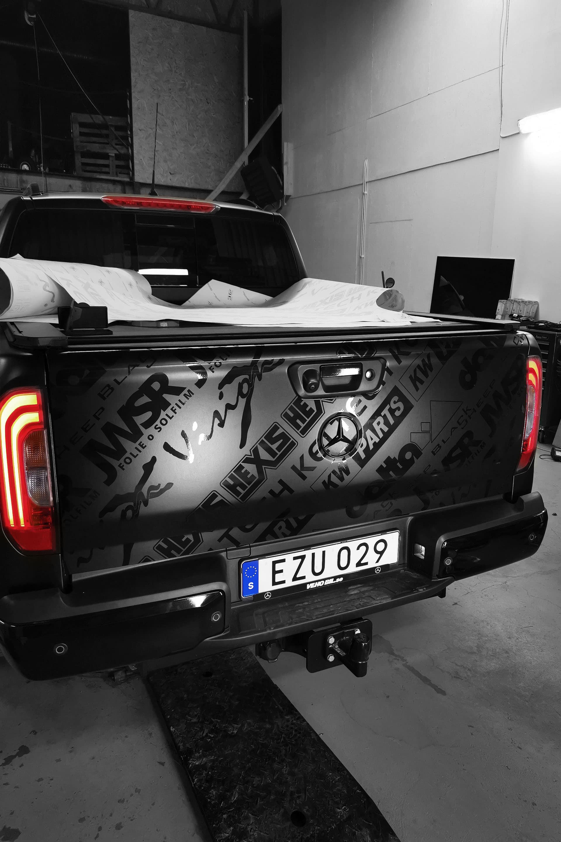 The logos on the back section were placed in diagonal lines in a glossy black wrap on top of the matte black.