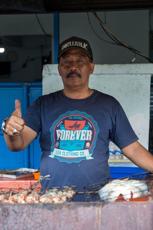 A street vendor offering ikan bakar in Yogyakarta.