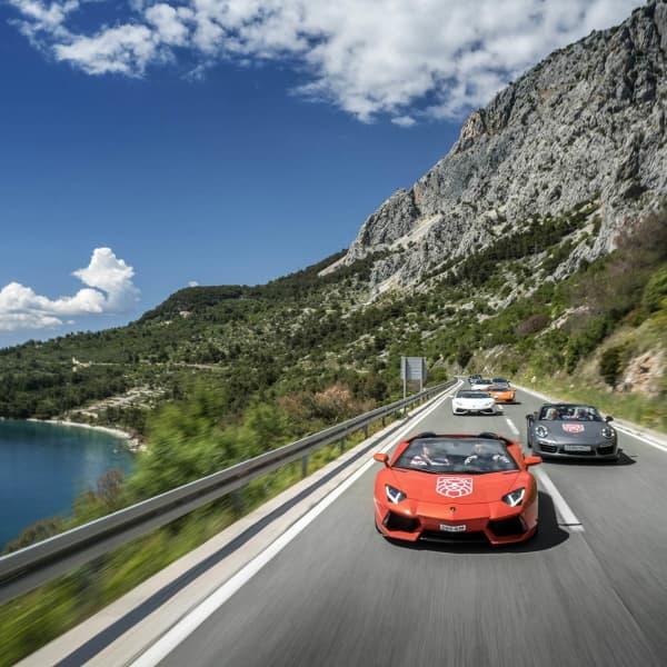 Supercars on the coastal road in Croatia during the annual Gran Turismo Adriatica event.