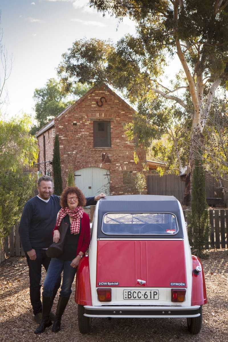 Daniel Burgermeister and Glenny Eastwood, with Dolly Glenny's beloved 2CV, behind is Red Brick Barn the couples B&B accommodation.