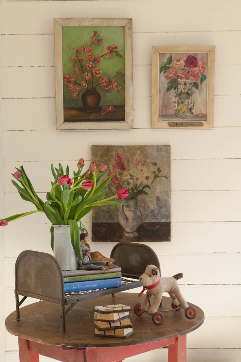 Some of Daniel's fleamarket painting finds are displayed in the sitting room.