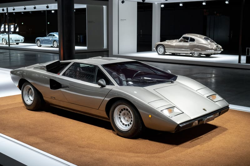 """This masterpiece and perhaps the world's most famous iconic car is undoubtedly designer Marcello Gandini's Lamborghini Countach.The model was first shown at Geneva's car show in 1971. The name arose when one of the craftsmen at the factory spontaneously exclaimed contacc"""" when he first saw the car. """"Contacc"""" is Piedemonte dialectand can be loosely translated into """"wow"""".In 1974, the finished car rolled out from the factory and could reach a speed of 300 kilometers per hour even back then thanks to its shape and the powerful V12 engine."""