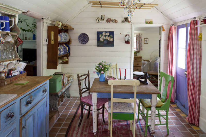 The tiny original kitchen in the cottage is the heart of the home and a great place to display lots of the items the couple collects on their travels.