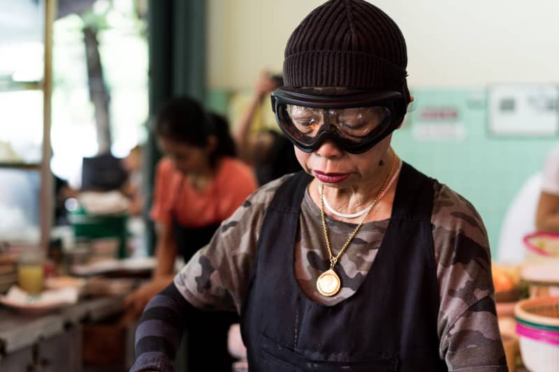 Legendary Jay Fai in her street food kitchen in Bangkok