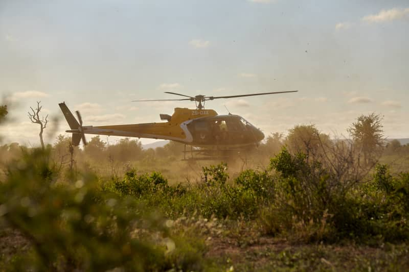 Getting on with the job - the antipoaching helicopter moves along to the next objective.