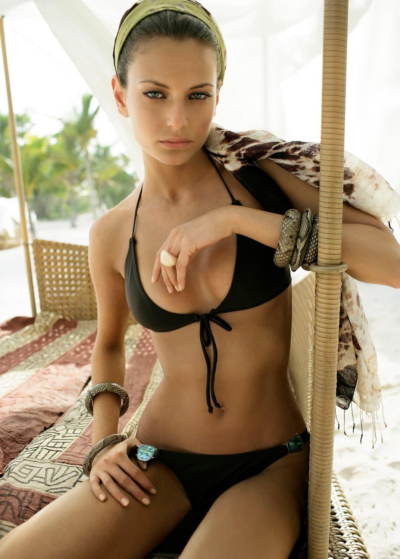 Bikini and headscarf, Liza Bruce. Bone ring, Catherine Prevost.