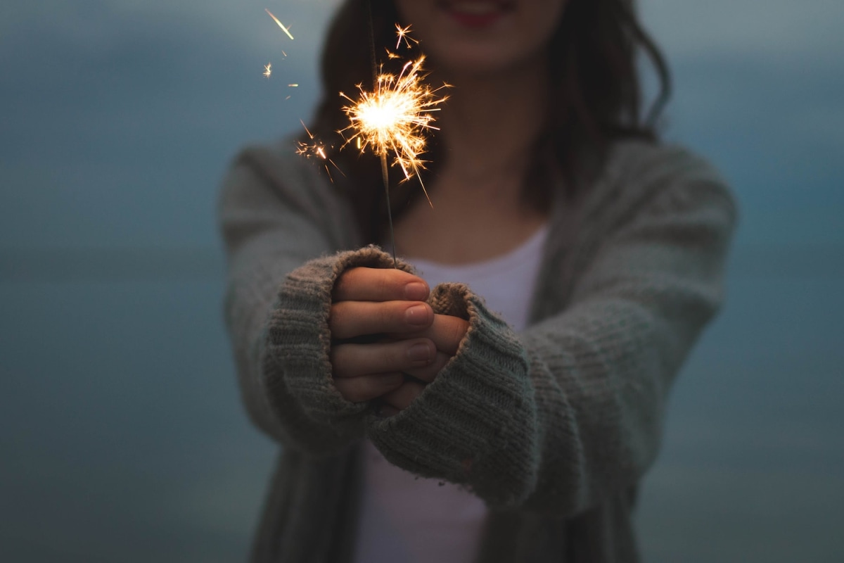 women with a sparkler