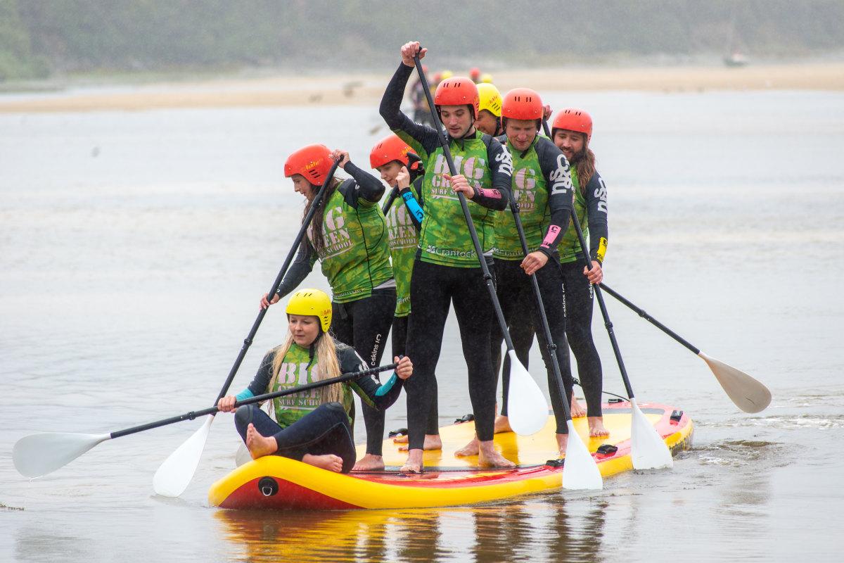 big green surf school team eola monster sup