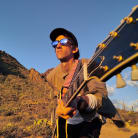 """Delicate Steve Performs New Song """"Green"""" Alone In The Desert, Watch + Listen Now"""