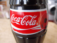 Coca-Cola Revenue Disappoints, Drags Blue-Chips Lower