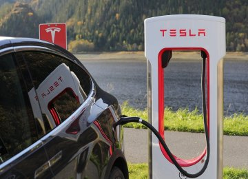 This Stock Is Like Tesla, Minus the Risk