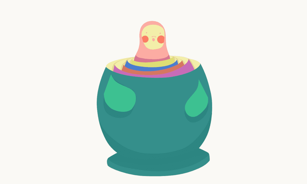 A small Matroyshka head popping out of a bunch of nested bottoms