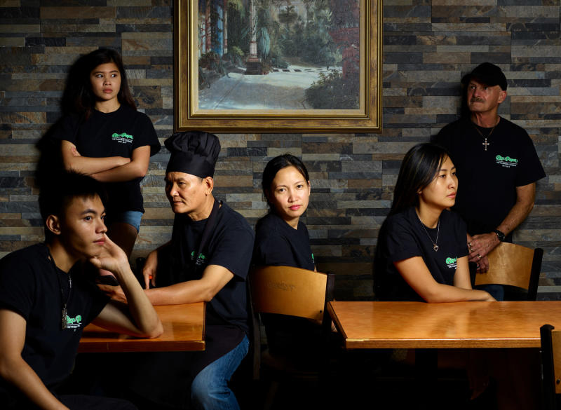 Owner Emily Hoang (center) and her staff