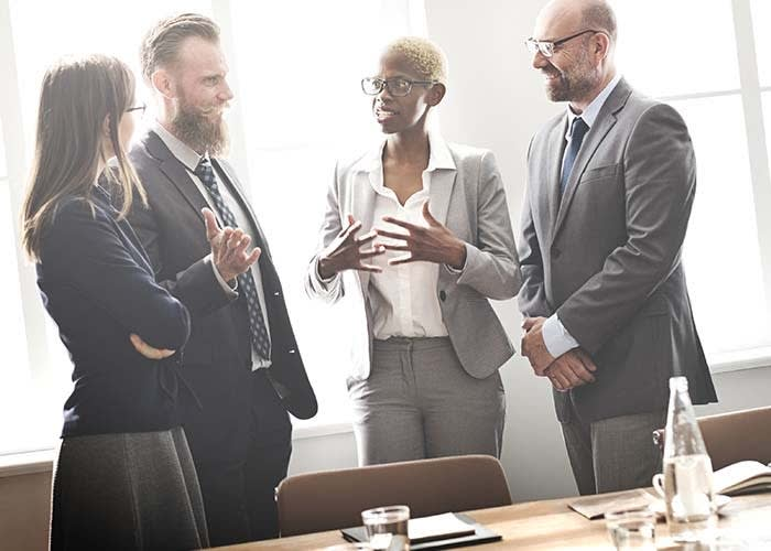 Picture of four people in a discussion.
