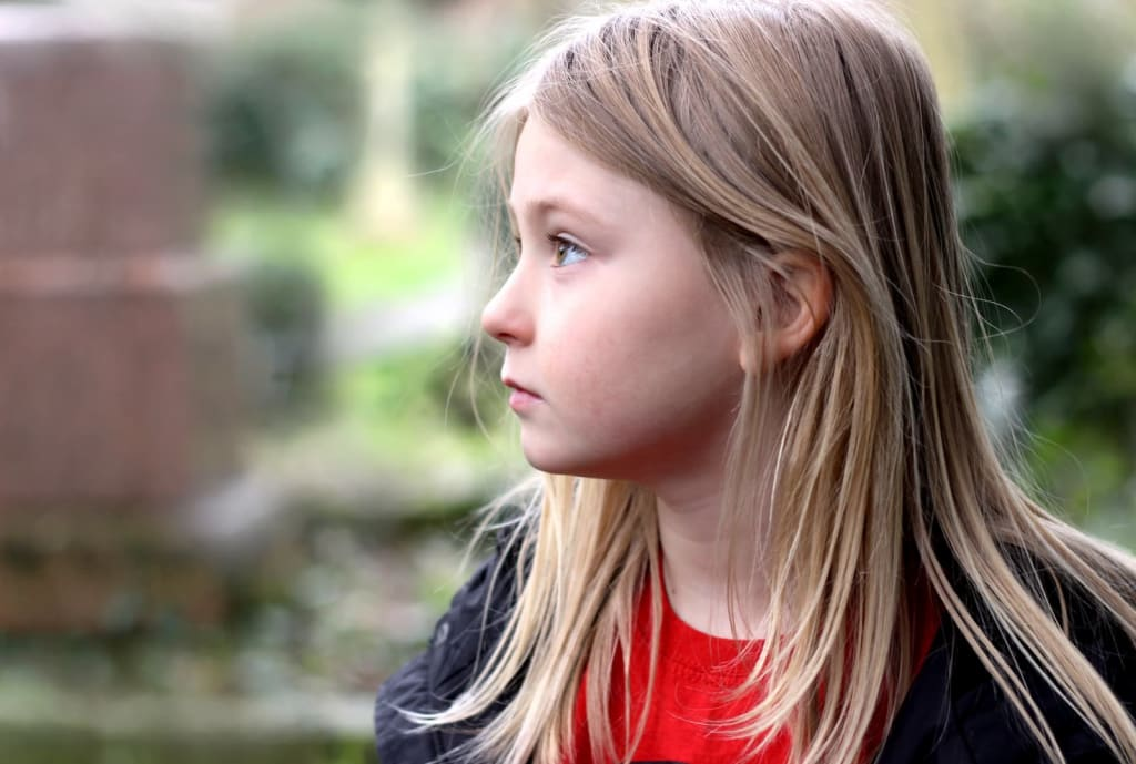 Child looking off to the distance mental health