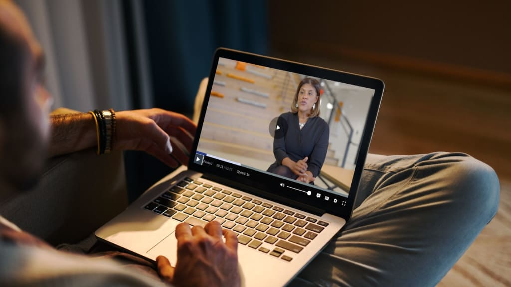 Person watching video on laptop