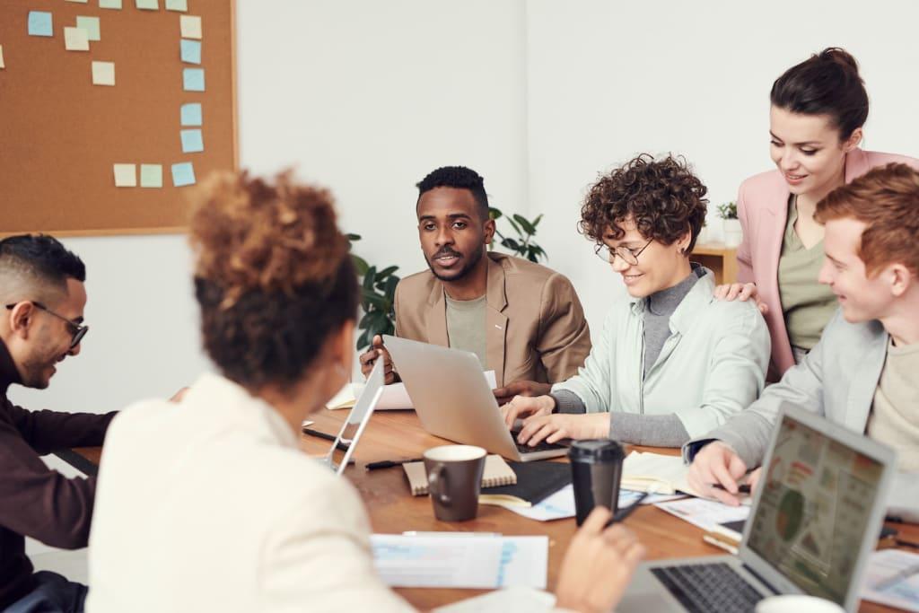 Diverse team working together at community desk