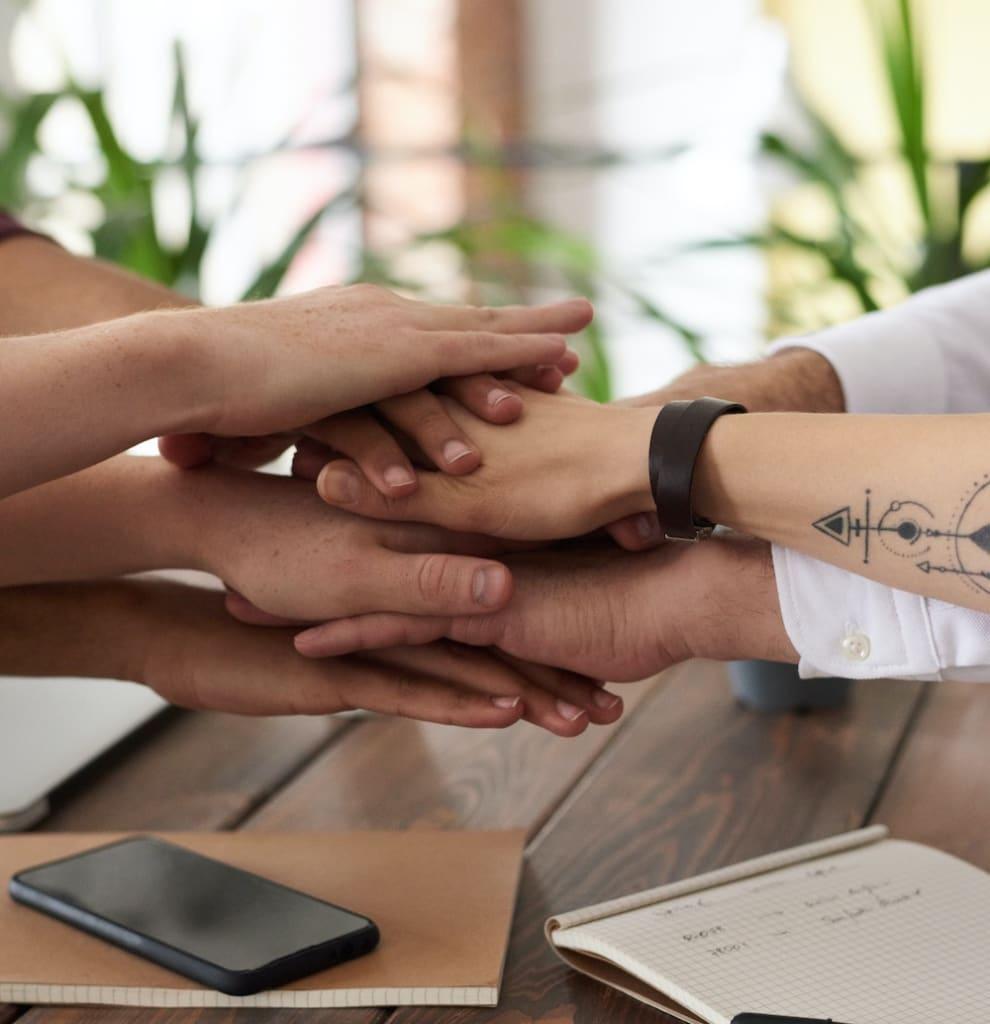 Multiple hands together