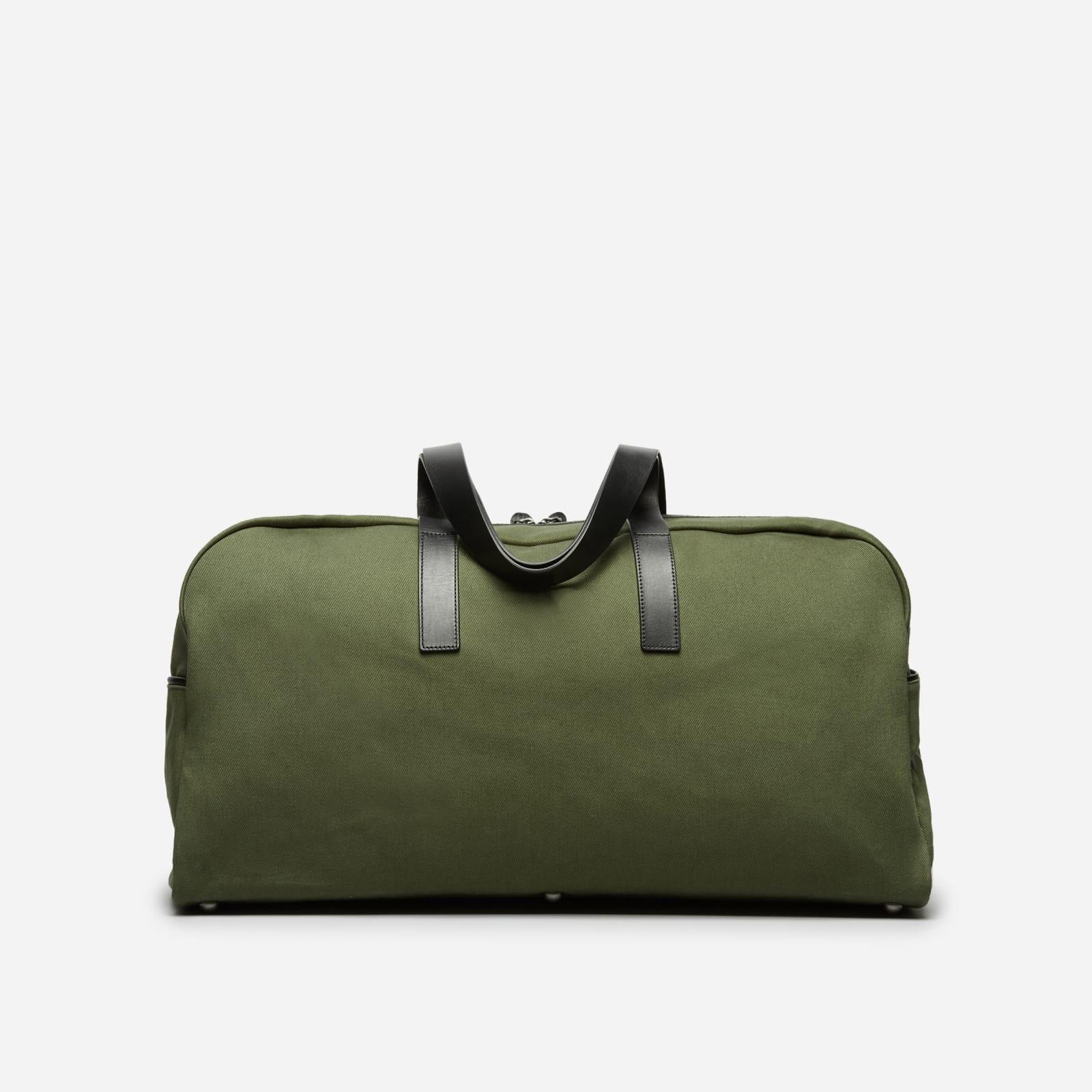 twill weekender bag by everlane in dark green
